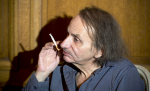Michel Houellebecq: 'looks like a man who has crawled out of an ashtray after a prolonged alcoholic binge in clothes that have not been washed for weeks. This does not mean he approves of the world he inhabits: it is that he can conceive of no other, at least for Western man, and if anyone thinks otherwise he is deceiving himself. Grunge is reality; everything else is veneer'