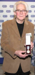 John Bryant with the RSPCA's highest honour, the Queen Victoria Gold Medal for 'long and meritorious service in the cause of animal welfare'