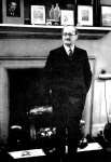 Crœsus of consultants: Thomas Horder, 1st Baron Horder, lords it over his patients in his consulting-room at 141 Harley Street. Note the photograph of Neville Chamberlain on the mantelpiece