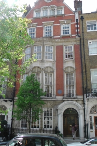 73 Harley Street. Architect: W. Henry White. The French Loire style, brick with plenty of terracotta decoration on a small, playful scale (Pevsner)