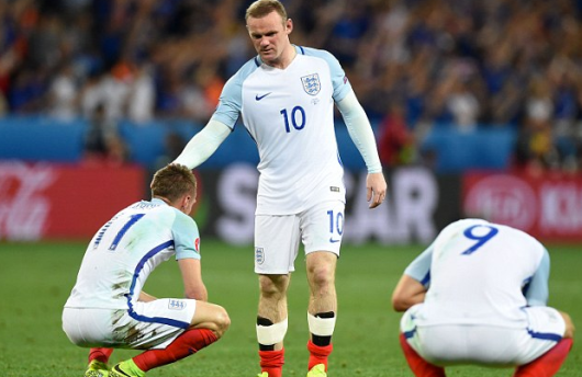 Rooney ruefully touches the hair of a fellow player in the national team after England's defeat at the hands of Iceland (population 330,000) at the 2016 UEFA European Championship